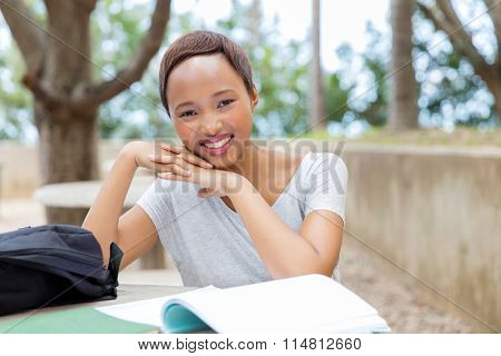 portrait of pretty african female college student on campus