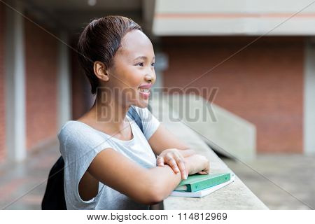 smart african american college student daydreaming on campus