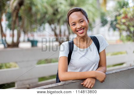portrait of pretty young black college student on campus