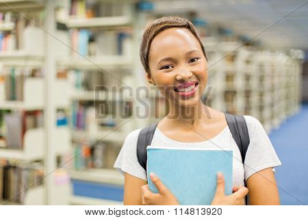 close up portrait of pretty african american university student in library