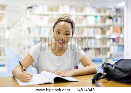 afro american student studying in university library