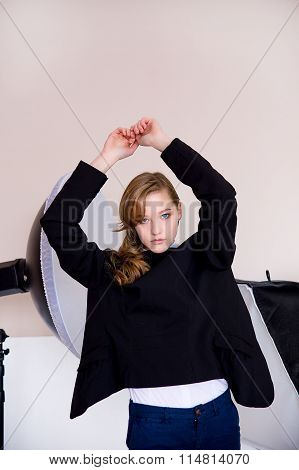 The Girl In A Jacket On A Beige Background