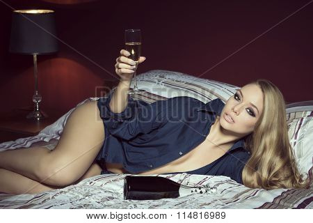 Glamour Woman Lying With Champagne