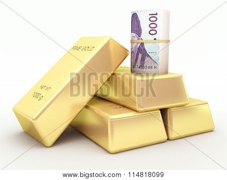 Korean won banknote roll and gold bars