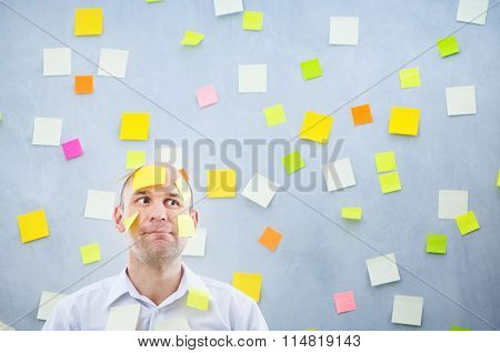 Businessman Overwhelmed With Sticky Reminder Notes