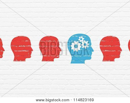 Learning concept: head with gears icon on wall background