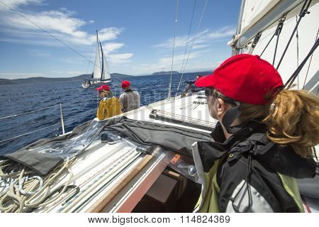 METHANA - POROS, GREECE - CIRCA MAY, 2014: Sailors participate in sailing regatta 11th Ellada 2014 among Greek island group in the Aegean Sea, in Cyclades and Argo-Saronic Gulf.