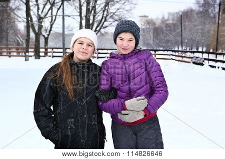 Two Teenager Girl On The Snowy White Background