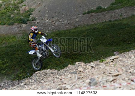 SOCHI, RUSSIA â?? AUGUST 16, 2014: Off-road motorcycle rider in summer mountains