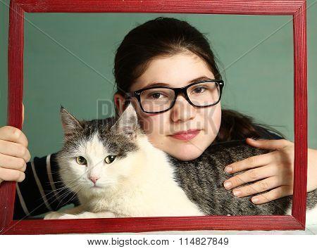 Girl In Myopia Glasses Hug Big Siberian Cat