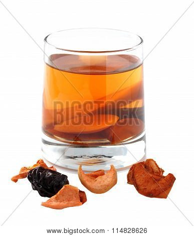 Assorted Dried Fruit Compote In A Glass On A White Background.