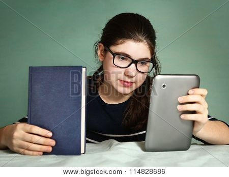 Girl Has  Choice Between Book And Modern Pad