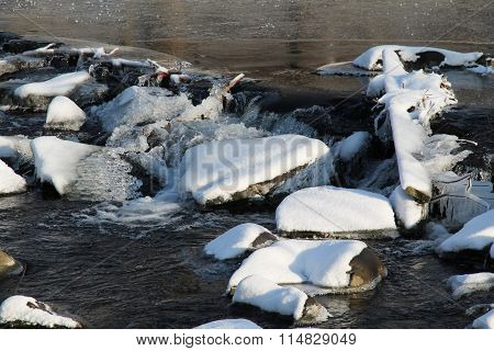 rocky weir in winter