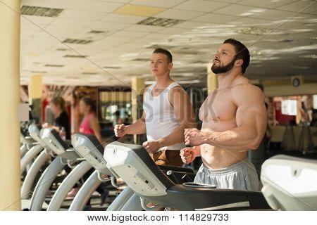 Two sportsmen in gym.