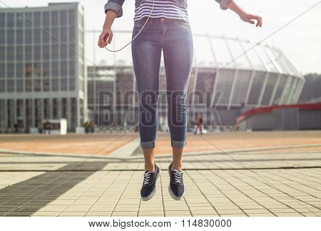 Young hipster woman jump in the city