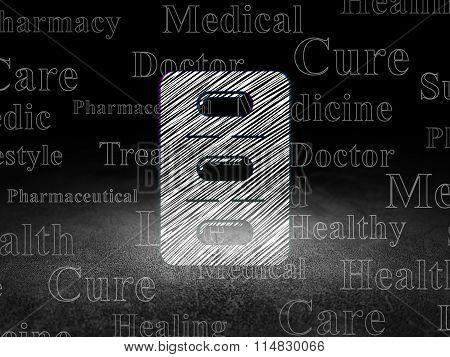 Health concept: Pills Blister in grunge dark room