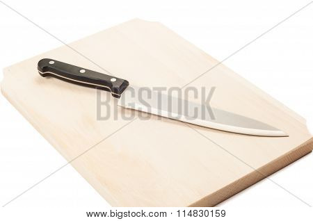 Cook Knife On A Wooden Board..
