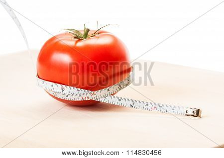 Measure Calories Of A Red Tomato With A Centimeter. Diet Concept..