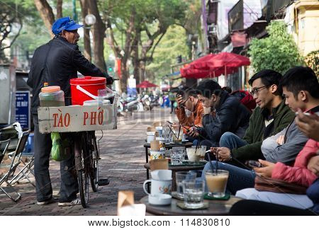 Asian vendor selling soft and fresh tofu carried on his bicycle