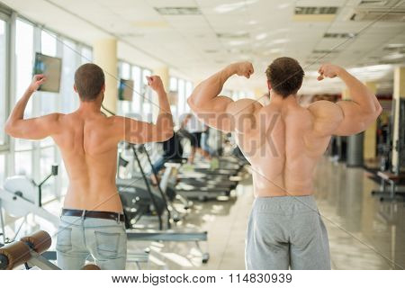 Two guys in gym.