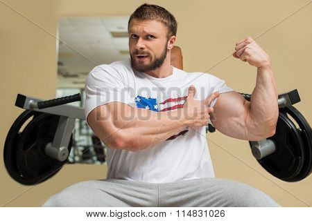 Strong man with huge muscles.