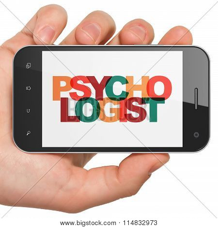 Medicine concept: Hand Holding Smartphone with Psychologist on  display