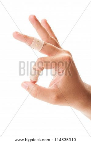 Ok Or Perfect Sign Using Hand With Patches On Fingers.