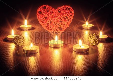 Red heart with candles.