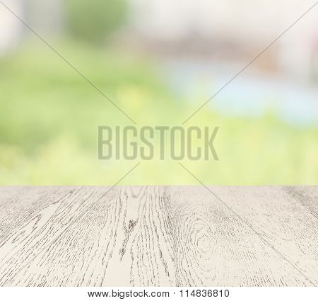 White wooden table on blurred nature background