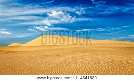 Panorama of White sand dunes in desert on sunrise, Mui Ne, Vietnam.