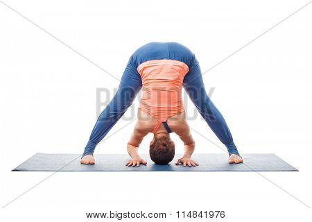 Beautiful sporty fit woman practices Ashtanga Vinyasa yoga asana Prasarita padottanasana A - wide legged forward bend A isolated on white background