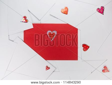 Red envelope between white ones