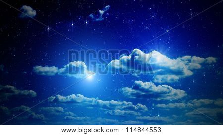 Stars on a dark sky with some clouds.