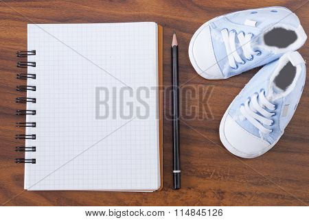 Notebook And Baby Shoes