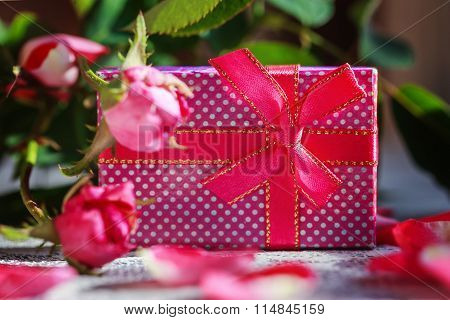 Colorful Gift Box With  Old Roses Background. Copy Space