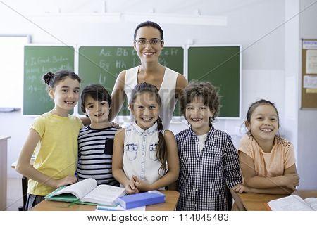 Children with teacher at school