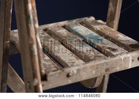 Paint-splattered Summit Of An Old, Wooden Stepladder