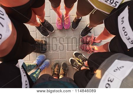 Feet Of Runners Standing In A Circle