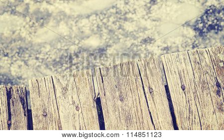 Retro Toned Old Wooden Pier On Ice, Shallow Depth Of Field.