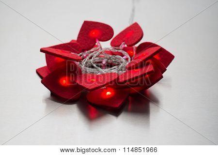 Illuminated Red Felt Hearts In A Circular Arrangement