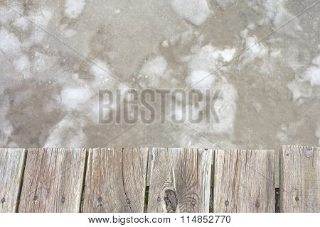 Old Wooden Pier On Ice, Abstract Background With Space For Text.