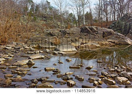 Large rocks in the water at Great Falls Park Maryland USA.