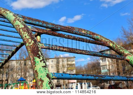 Rusty Jungle Gym With Leafless Paint At Playground