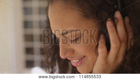 Closeup Of A Beautiful Young Latino Woman Wearing Headphones