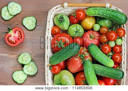 Fresh Cucumbers, Red And Green Tomatoes , The Top View.
