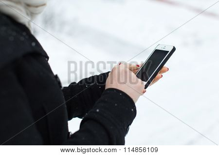 Woman Typing On The Smartphone