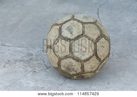 Old football on a concrete surface