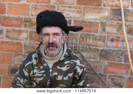Portrait of an ordinary mustached Ukrainian peasant in fur cap