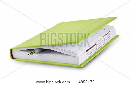 Closed diary with pen