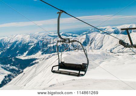 Skilift on ski resort during winter on bright day